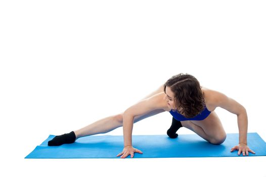 Fit female model in crouching posture