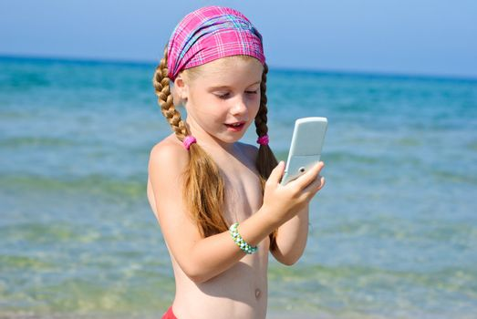 A little girl with cellular phone