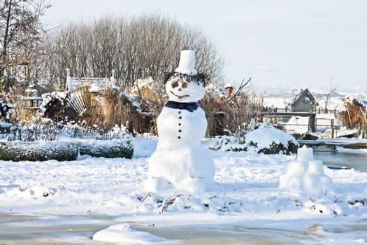 Traditional snowman in wintertime in the Netherlands
