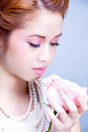 beautiful young woman with jewellery and rose sensuality valentine romance love