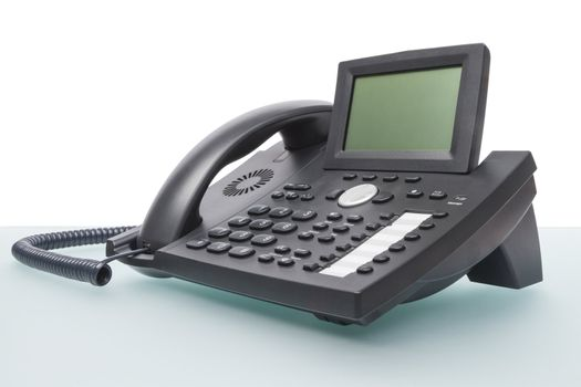 modern new telephone on desk with blank display