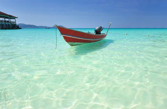 Beautiful beach with motor boat