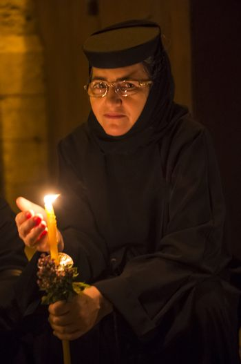 JERUSALEM - AUGUST 25 : Unidentified nun take part in a candle procession as part of the feast of the Assumption of the Virgin Mary on August 25 2012 in old Jerusalem Israel
