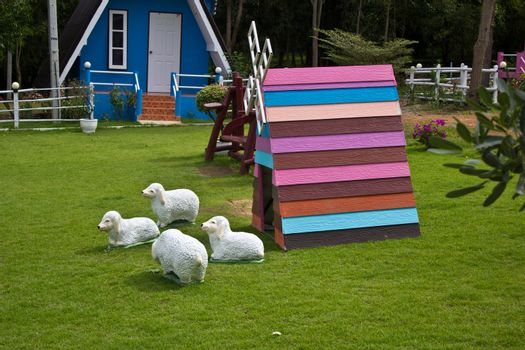 wooden windmill with sheep