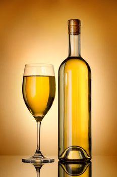 Bottle over gold background
