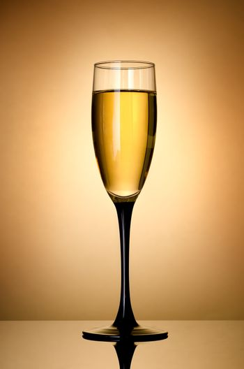 Wineglass  over gold background