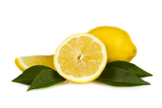 Fresh lemon fruits with leaves over white background