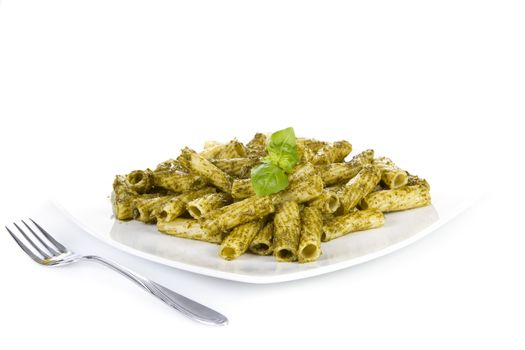 Pasta with pesto sauce  over white