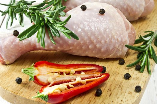 Fresh - raw chicken drumsticks on chopping board