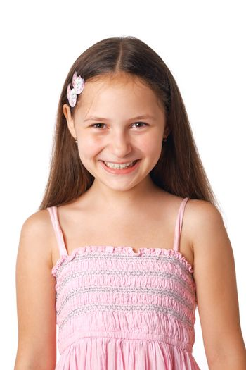 Portrait of a happy Caucasian girl smiling on white background.
