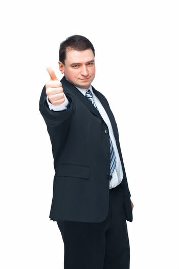 Portrait of a confident middle aged business man showing a success sign over white