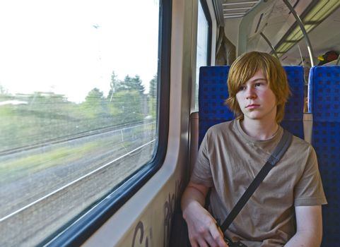 boy waiting in the station for the train
