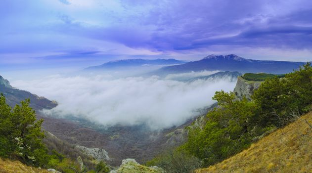 Panorama of Beautiful Mountain Landscape with Low Clouds