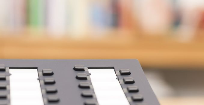 detail of modern telephone with blurred background