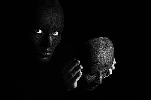 an image of two disguise on a black background