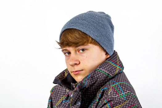 portrait of freezing boy in winter clothes