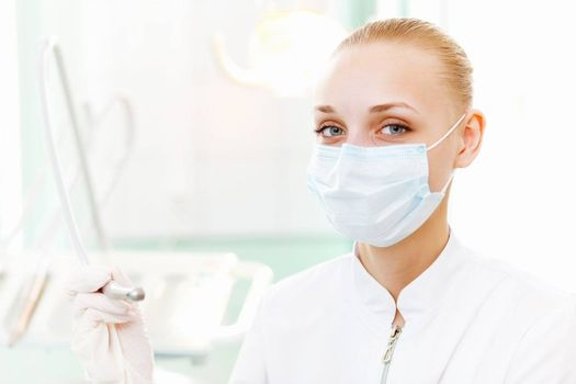 A portrait of a dental worker, dentist or assistant