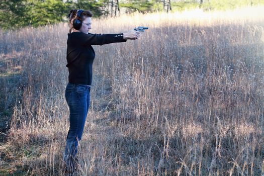 Woman Shooting a Firearm