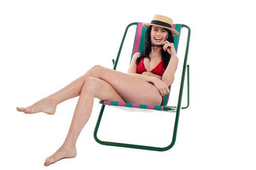 Seductive bikini woman relaxing on a deckchair