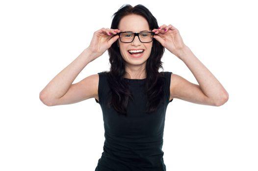 Charming lady adjusting her eyeglasses