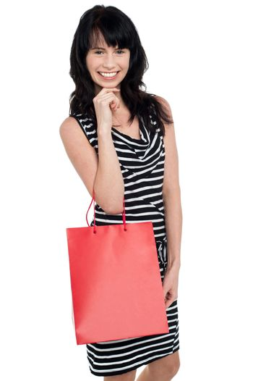Portrait of a young shopaholic woman