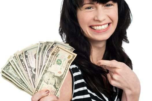 Smiling woman with cash