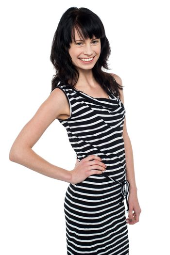 Fashionable young girl in trendy sleeveless attire