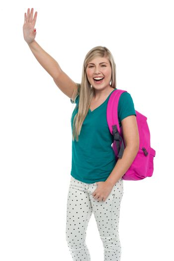 Excited college student waving her hand