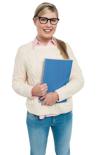 Pretty college student posing with spiral notebook