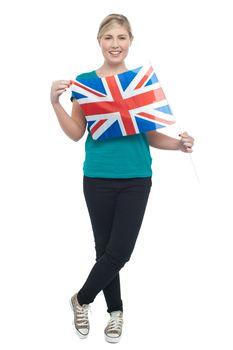 Cute blonde UK supporter striking stylish pose