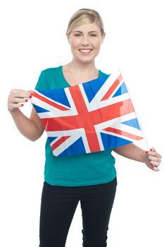 Proud UK female supporter holding national flag