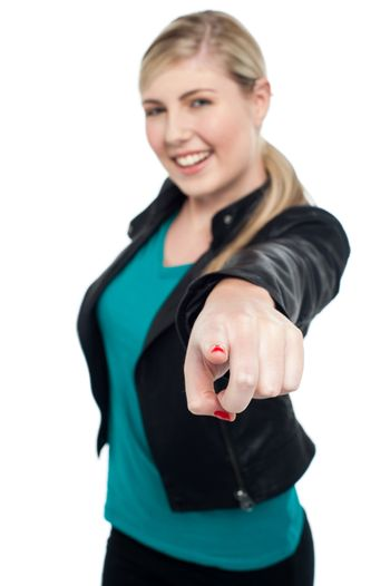 Fashionable teen in leather jacket pointing at you
