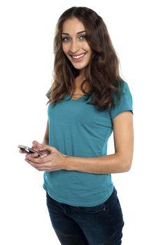 Joyous woman messaging her boyfriend
