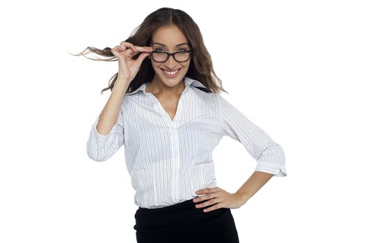 Young businesswoman adjusting her spectacles
