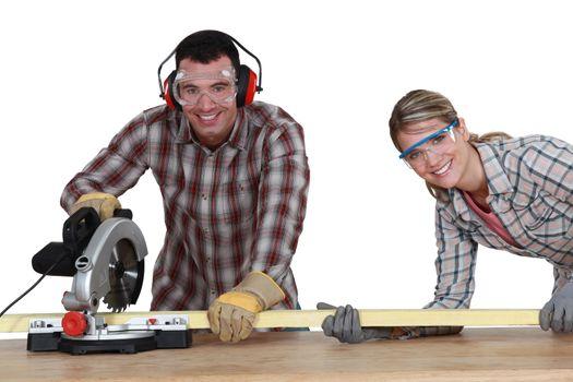Couple using circular saw