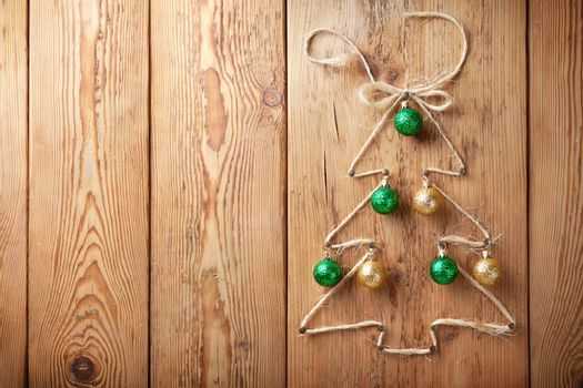 Christmas tree with balls on wooden background with copy space