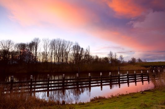 colorful sunrise over canal