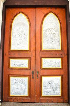 Jesus picture on silver carve art on door