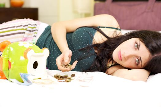 Woman at home laying in bed desperate not having a job left with few money