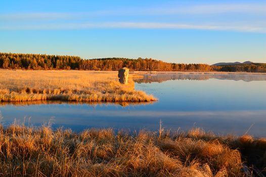 Sunrise landscape of lake in Bashang grassland,Hebei province, China
