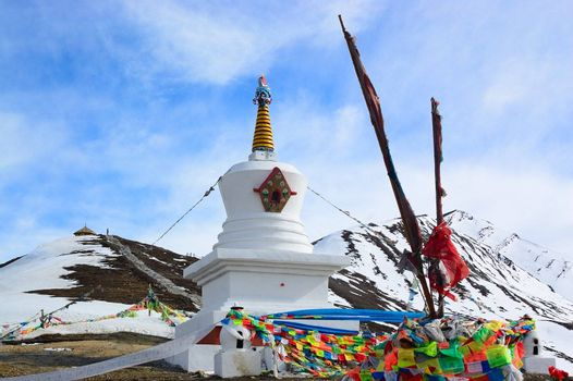 White Tibetan pagoda near the snow mountain in Sichuan province, China
