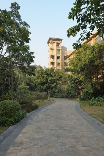 Road in the garden of a modern hotel