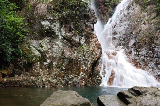 Flowing stream waterfall in China mountain areas