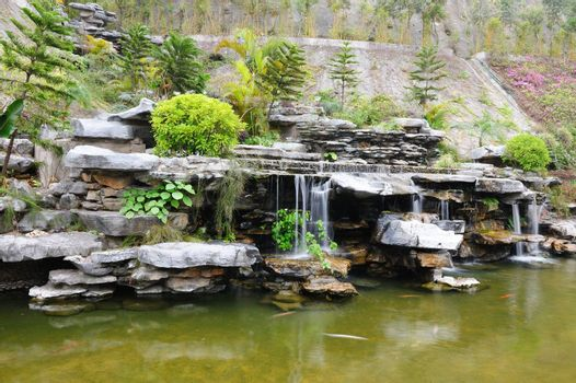 Chinese rockery garden with pond and waterfall
