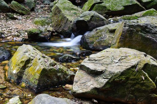 Closeup view of the rocks near the stream in mountain areas