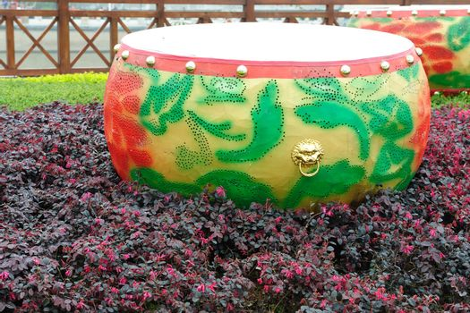 Drum statue -Chinese traditional musical instrument - in the urban garden