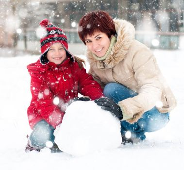 Happy family with snowman winter portrait