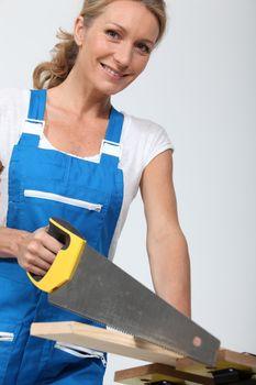 Woman sawing