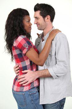 Mixed-race couple hugging