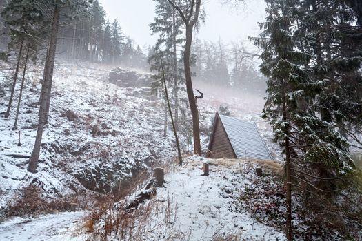 wooden hut in winter mountains